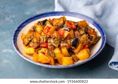 Turkish Kebab eggplant, potatoes, pepper and piece of meat. Vegetables kebab. Turkish cuisine tops view - Turkish name; Sebzeli Koz Kebab or sebze kebabi Stok fotoğraf ©
