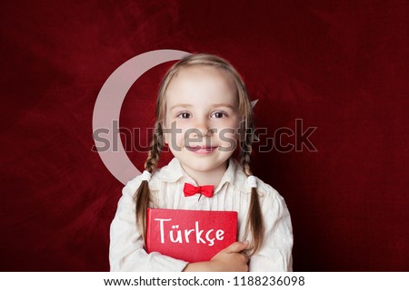 Turkish language concept. Cute child girl student on the Turkey flag background. Learn turkish language