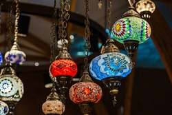 Turkish luminous chandeliers hanging from the ceiling in the Istanbul Bazaar.