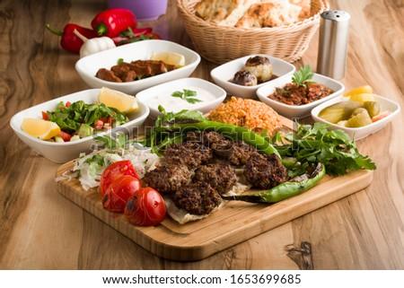 turkish meatball with garnitures on wooden table Stok fotoğraf ©