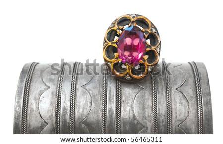 Turkish Ottoman ring with pink tourmaline on antique bracelet - stock photo