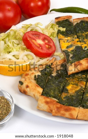 turkish pide with spinach and salads - stock photo