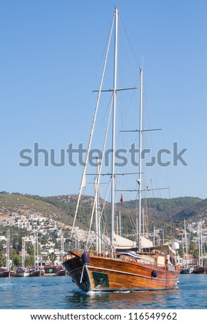 Turkish sailing boat leaving Bodrum harbour , Turkey.