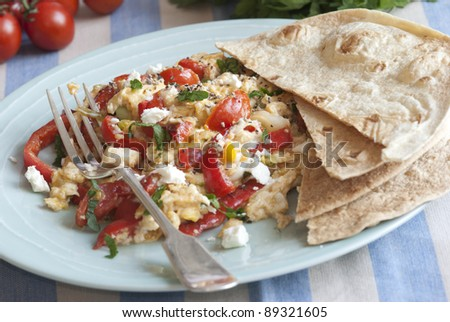Turkish scrambled eggs, tomatoes and feta with wholemeal wraps