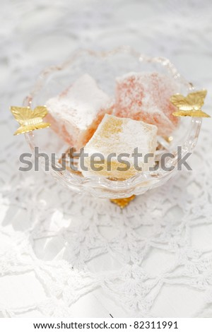 turkish sweet delight, rose and yellow, in small glass bowl butterfly decorated