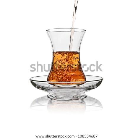 Turkish tea glass splash in sufficient amount on white background