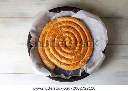 Turkish Tepsi Boregi, Round Borek, Tray pastry (Turkish name; rulo borek) Stock fotó ©