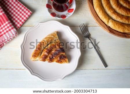 Turkish Tepsi Boregi, Spinach Round Borek, Tray pastry (Turkish name; ispanakli rulo borek) Stock fotó ©