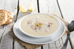 Turkish Traditional Tripe Soup with bread on white rustic wooden background. / iskembe, kelle, paca corbasi.