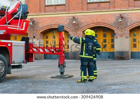 TURKU/FINLAND - FEBRUARY 27, 2013; The Fire depatrment and the fire truck.