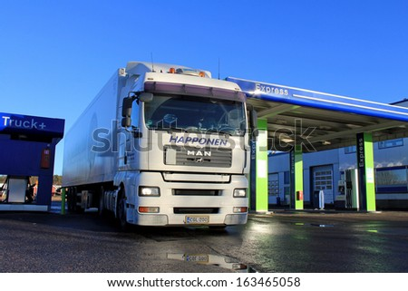 TURKU, FINLAND - NOVEMBER 16: MAN 18.480 truck refueled on November 16, 2013 in Turku, Finland. MAN Truck&Bus expect often more favorable fuel consumption for their Euro 6 vehicles compared to Euro 5.