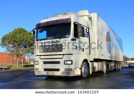 TURKU, FINLAND - NOVEMBER 16: White MAN 18.480 truck on November 16, 2013 in Turku, Finland. MAN Truck&Bus expect often more favorable fuel consumption for their Euro 6 trucks compared to Euro 5.