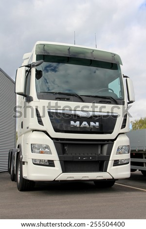 TURKU, FINLAND - SEPTEMBER 15, 2013:  MAN TGX 26.480 Euro 6 truck tractor parked. According to the TUV Report 2014, MAN is the most reliable brand of trucks weighing over 7.5 tonnes.