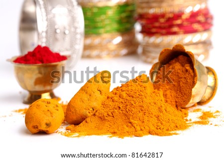 Turmeric and kumkum powder arrangements - stock photo
