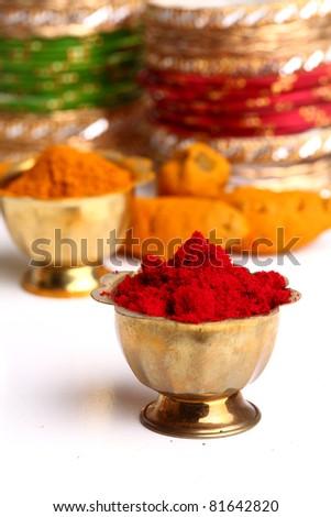 Turmeric and kumkum powder arrangements