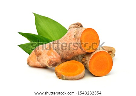 Turmeric (Curcuma longa Linn)  rhizome (root) sliced with green leaves isolated on white background.