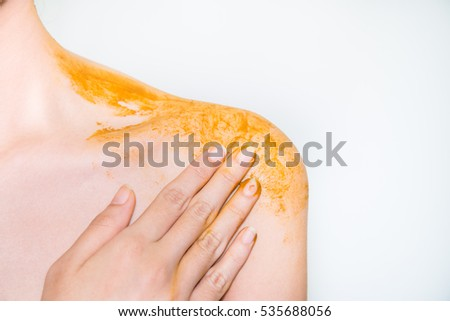 Turmeric in spa on body woman on white background #535688056