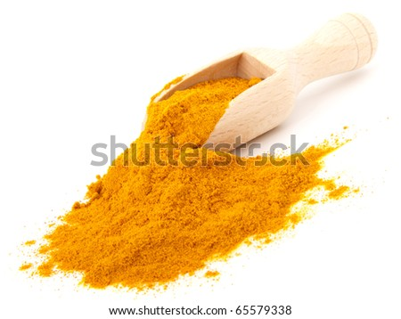 turmeric over the spoon,  isolated on white background