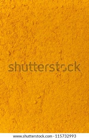 turmeric powder background, yellow grain abstract texture - stock photo