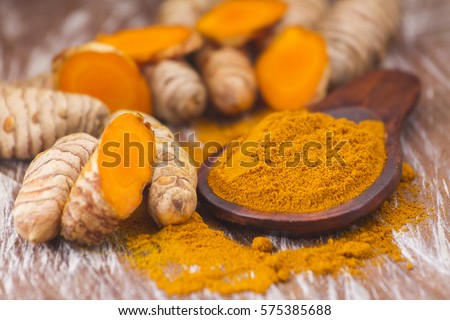 Shutterstock Turmeric root and powder (Curcuma longa)