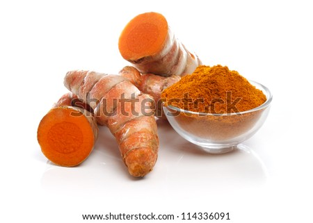 Turmeric roots and powder on white background