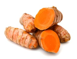 Turmeric roots on white background