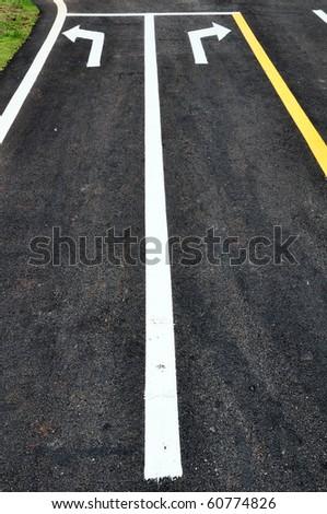 turn arrow traffic symbol on street surface - stock photo