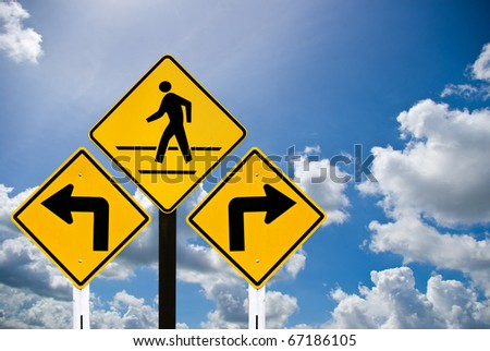Turn left and turn right sign and a man walking sign with cloudy sky