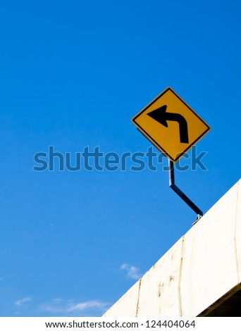 Turn left sign with blue sky