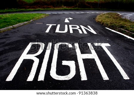 Turn right - a sign on a road instructing drivers to turn right at the junction