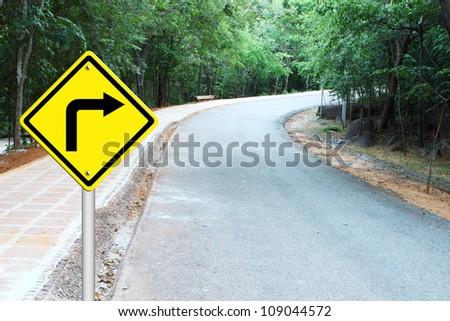 Turn right warning sign on a curve road