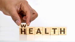 Turn the message on the wood block from health to prosperity, healthcare concept and a sustainable financial future.