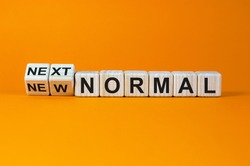 Turned cubes and changed the words 'new normal' to 'next normal'. Covid-19 postpandemic concept. Beautiful orange background, copy space.