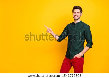 Turned photo of confident cool worker man promoter point index finger copyspace present adverts recommend sales discounts wear good looking clothing isolated over yellow color background