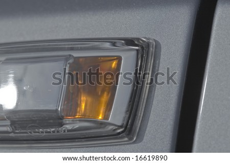 Turning signal on a car in a close up