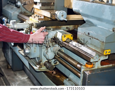 Turning work. A man working on the machine