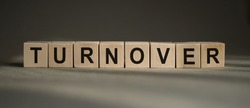 TURNOVER word on wooden cubes. Business concept.