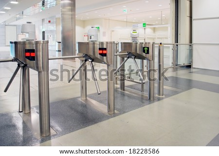 Turnstile entrance and exit gates at big event or trade center