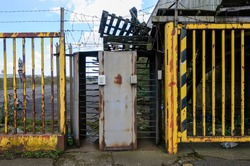 Turnstiles at the entrance of a closed-down factory.