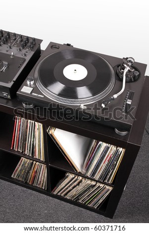 Turntable and Dj mixer on black table,closed-up in studio