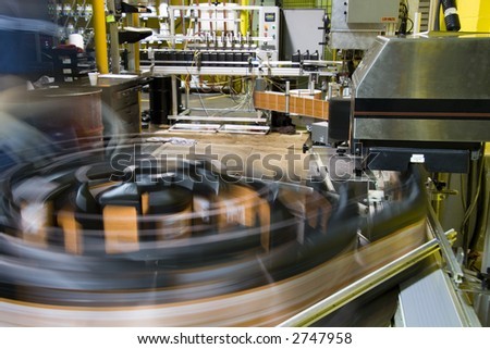 Turntable of bottling line at a lubricant manufacturing facility stock photo