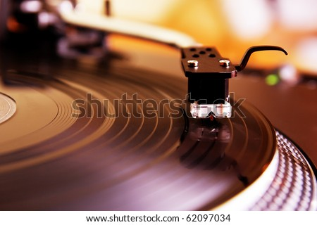 Turntable record player with vinyl disc. Close up on needle. Top level expensive audio equipment for DJ, also can be used as Hi-Fi for audio enthusiast.