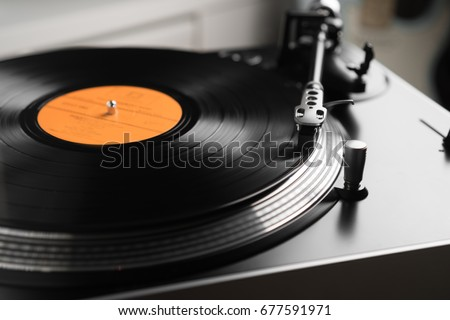 Turntable vinyl record player is playing music #677591971