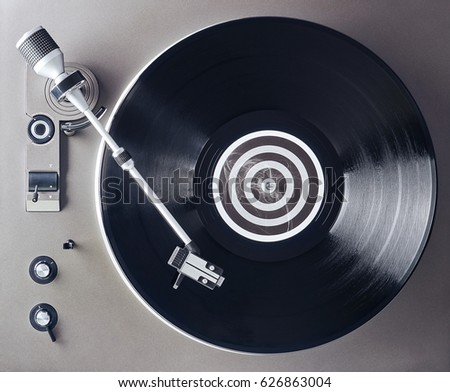 Turntable vinyl record player. Retro audio equipment for disc jockey. Sound technology for DJ to mix & play music. Black vinyl record