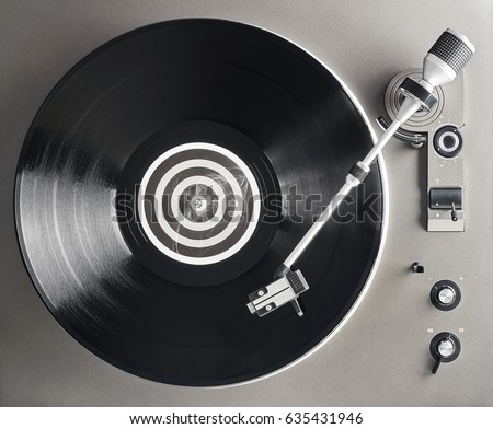 Turntable vinyl record player. Retro audio equipment for disc jockey. Sound technology for DJ to mix & play music. Black vinyl record                                                               #635431946