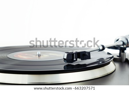 Turntable vinyl record player. Retro audio equipment for disc jockey. Sound technology for DJ to mix & play music. Black vinyl record. Vintage vinyl record player. Blurred needle on a vinyl record