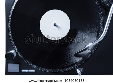 Turntable with black record and headshell, closeup top view