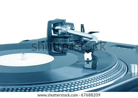 Turntable with dj needle on spinning record, closeup