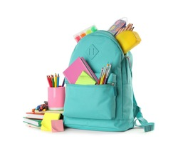 Turquoise backpack with different school stationery on white background