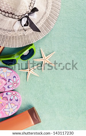 turquoise beach towel with several summer stuff